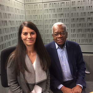 Madeleine sitting next to Trevor McDonald