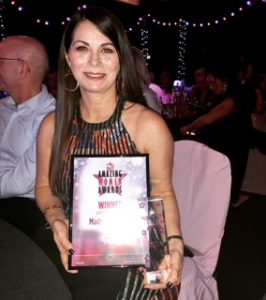 madeleine black holding No1 magazines award for Amazing Women